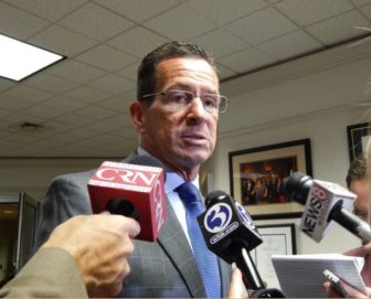 Gov. Dannel P. Malloy speaks to reporters after addressing housing advocates at the Hartford offices of the Community Renewal Team Wednesday.