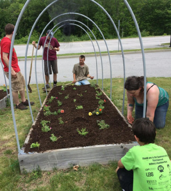Students work at the community garden planted at Three Rivers Community College.