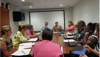 The Community Care Team brainstorms about care plans for some of its 208 clients.