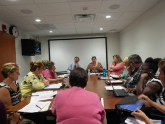 The Community Care Team at one of its Tuesday meetings to discuss care plans for some of its 208 clients.