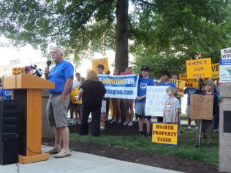 Resident Ray Crossen speaks Tuesday at a rally protesting a proposal for a state police gun range in Willington.