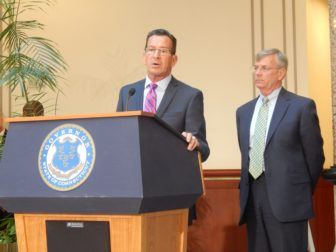 Gov. Dannel P. Malloy and Transportation Commissioner James P. Redeker answer reporters' questions after a State Bond Commission meeting Tuesday.