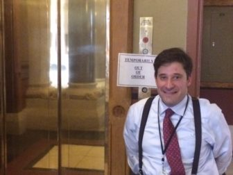 Jonathan Slifka, with the elevator plays a role in determining what access the disabled have at the Capitol.