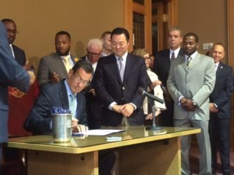 "Gov. Dannel P. Malloy signing his ""Second Chance Society"" bill."