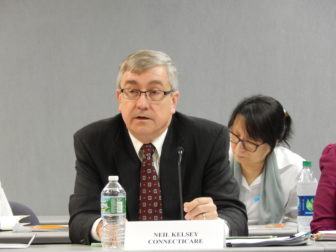 Neil Kelsey, ConnectiCare's chief actuary, testifies on the company's rate proposal at a hearing.