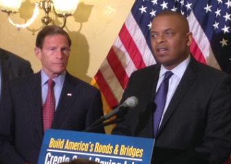 U.S. Sen. Richard Blumenthal and U.S. Secretary of Transportation Anthony Foxx, at podium.