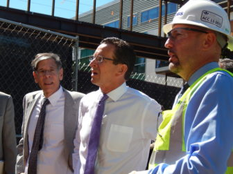 Gov. Dannel P. Malloy views the construction site where an outpatient center was being built on the UConn Health Center campus in Farmington. At left is Dr. Frank Torti, then the dean of the medical school.