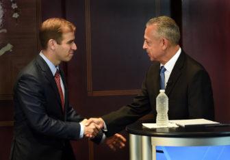 HARTFORD-8/19/15- hc-hartford-mayoral-Hartford Mayoral Candidates Luke Bronin, left, and Mayor Pedro Segarra shake hands before a debate held at The Hartford Courant.