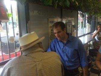 Luke Bronin campaigning on Park Street, the heart of the city's Puerto Rican community.