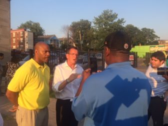 Rep. Douglas McCrory and Gov. Dannel P. Malloy outside a community meeting on violence called by Luke Bronin.