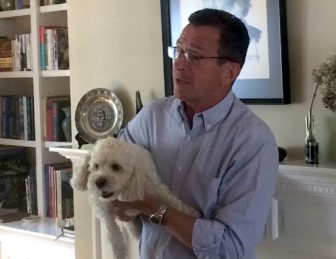 In August, Gov. Dannel P. Malloy had an easier time grabbing his New Hampshire audience's attention once he picked up the family dog, Bella.