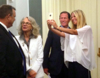 Actress Gwyneth Paltrow snaps a selfie with Sen. Richard Blumenthal during a GMO-labeling advocacy event. Her mother, actress