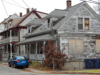 A boarded-up house in Willimantic.