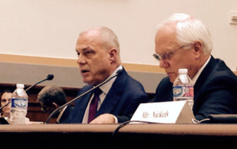 Aetna CEO Mark Bertolini, left, and Joseph Swedish, president of Anthem.