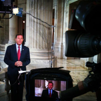 Sen. Richard Blumenthal explaining his vote on the Iran deal in front of a camera from MSNBC.