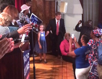 Luke Bronin and his daughter take the stage Tuesday night after winning the Democratic mayoral primary in Hartford.