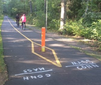 Bicyclists cross the state line from Suffield into Massachusetts last weekend.