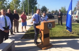 Gov. Dannel P. Malloy with John Colon, a daily commuter on CTfastrak. Commissioner James Redeker is at left.