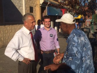 Mayor Pedro Segarra, left, and James Woulfe, a council candidate on Segarra's slate, campaigning.