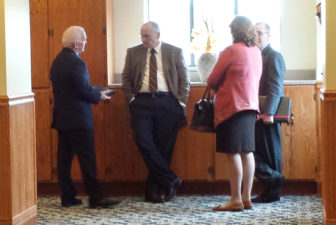 UConn officials involved in upcoming salary negotiations have a chat in the hall. They are, l-r, Michael Bailey, ; UConn Ombuds Officer Jim Wahl; Provost Sally Reis and Michael Eagen,