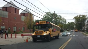 A school bus drops off students at a school in the south end of Hartford