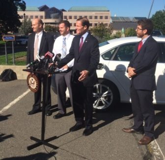 Sen. RIchard Blumenthal with, from left, Bruce E. Newman, Drew Mizak, Cory Guarnieri and Mizak's VW Passat.