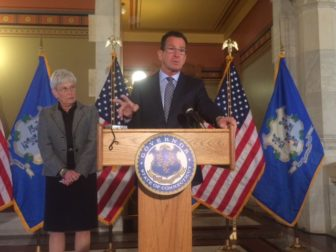 Gov. Dannel P. Malloy, with Lt. Gov. Nancy Wyman, calls for bipartisan budget talks.