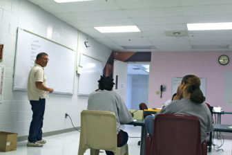 Eric Galm, a professor at Wesleyan University, teaches an Introduction to Music course to inmates at York Correctional Institute.