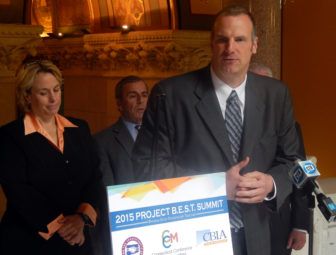 Lori Pelleiter and Joe Brennan speaking Tuesday at the State Capitol.
