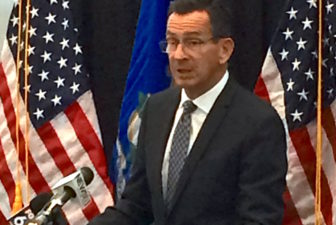 Gov. Dannel P. Malloy discusses his budget proposals to a meeting of state commissioners Monday.