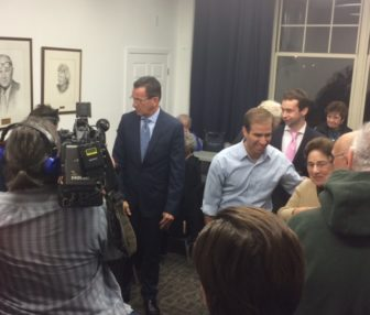 Gov. Dannel P. Malloy and Luke Bronin drop in on Democratic campaign workers Monday night.