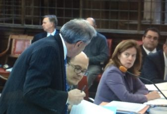 David S. Golub, left, making a point to opposing counsel, Assistant Attorney General Maura Murphy Osborne.