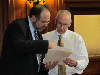 Mark Ojakian talking with then Education Commissioner Stefan Pryor on the floor of the state Senate during 2012