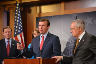 Connecticut Sens. Richard Blumenthal, left, and Chris Murphy, center, join Senate Majority Leader Harry Reid to urge tightening of the U.S. visa-waiver program.