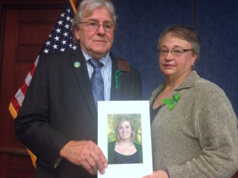 Gilles and Joyce Rousseau, father and stepmother of Lauren Rousseau, a teacher slain in the Sandy Hook Elementary shooting, hold her picture in Washington Thursday.