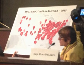 U.S. Rep. Rosa DeLauro with a map showing the sites of shootings this year.