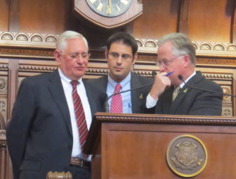 House Speaker J. Brendan Sharkey consults with legal staff, Rick Baltimore and Robert Frankel, over a GOP rules challenge.
