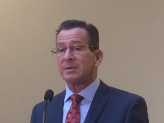 Gov. Dannel P. Malloy talking to reporters Friday.