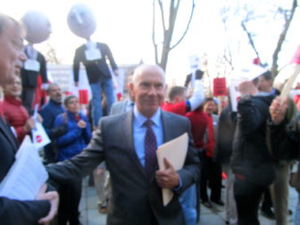 CSCU Mark Ojakian works his way through the protest