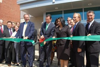 Gov. Malloy cuts the ribbon at JM Wright Technical High School, which the state spent millions to renovate.