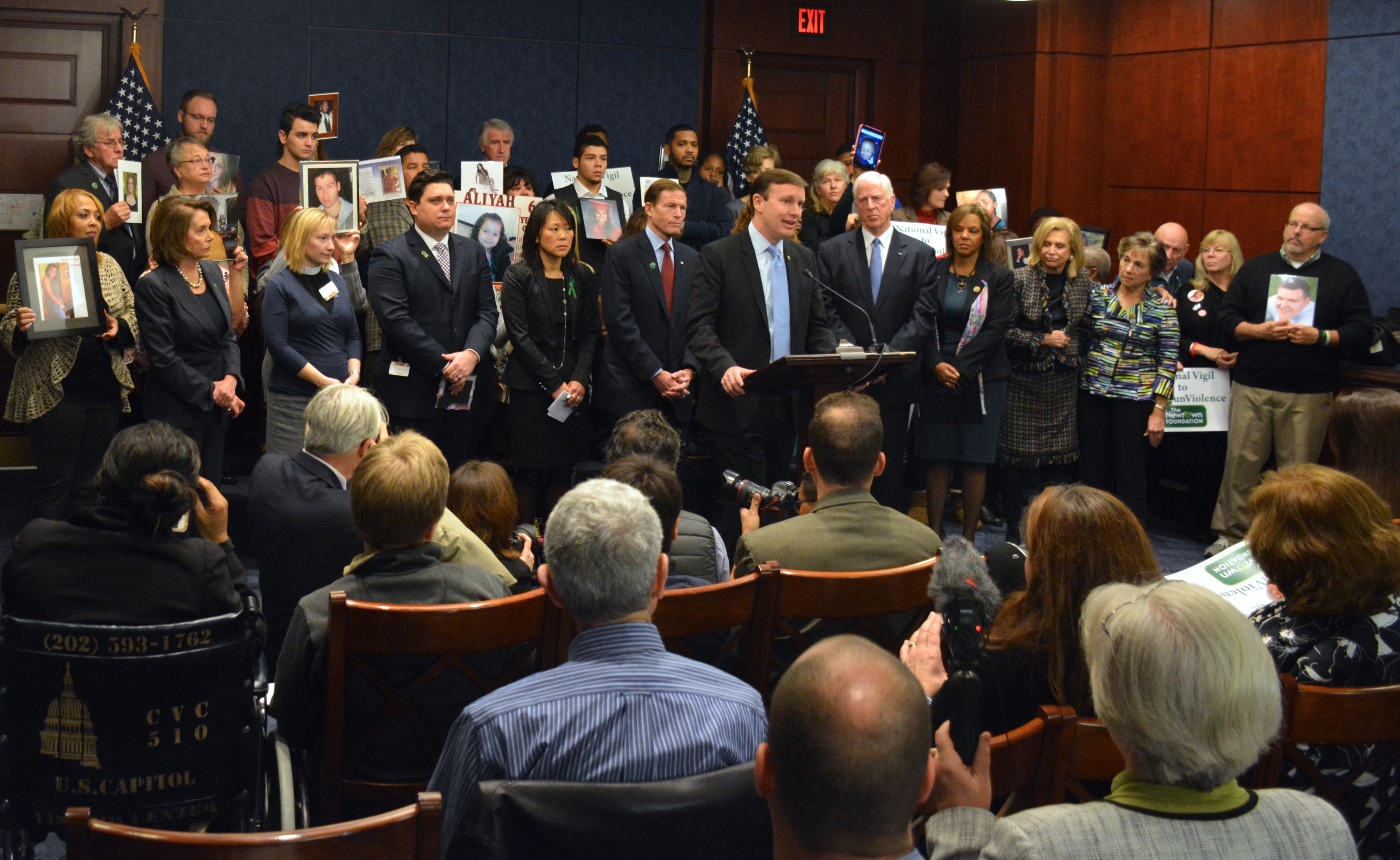 U.S. Sens. Richard Blumenthal and Chris Murphy, at podium, House Minority Leader Nancy Pelosi, standing far left, other congressional Democrats and family members of victims of gun violence