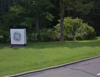 The GE logo marks the entry to its headquarter campus in Fairfield.