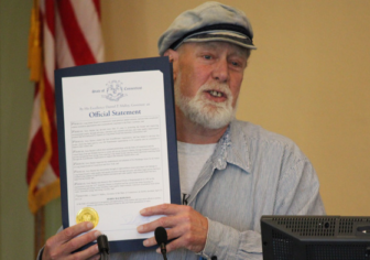 Terry Backer accepting a proclamation in 2012.