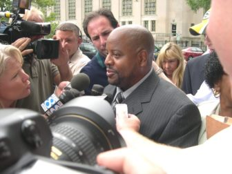 James Tillman surrounded by media after his release.