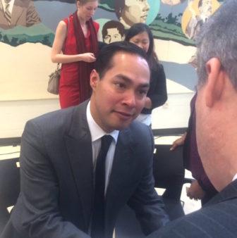 HUD Secretary Julián Castro talks to state Rep. Edwin Vargas.