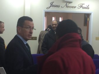 Gov. Dannel P. Malloy exits the Citadel of Love, a church where he outlined his Second Chance 2.0.