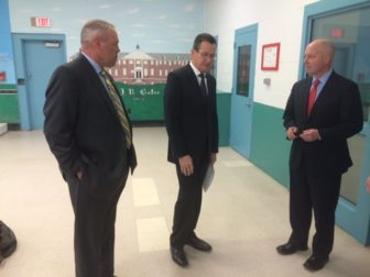 Gov. Dannel P. Malloy, on a recent prison visit, flanked by Scott Semple, left, and Michael P. Lawlor.