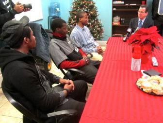 Gov. Malloy talks with three youth at a group home in Hartford for youth in the juvenile justice system.