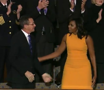 Gov. Dannel Malloy is greeted by First Lady Michele Obama as she enters the gallery.