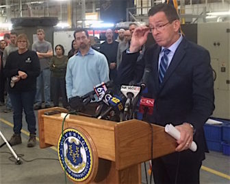 Gov. Dannel P. Malloy takes questions about GE at a hastily arranged appearance at Pegasus Manufacturing. At left is the company president, Chris DiPentima.